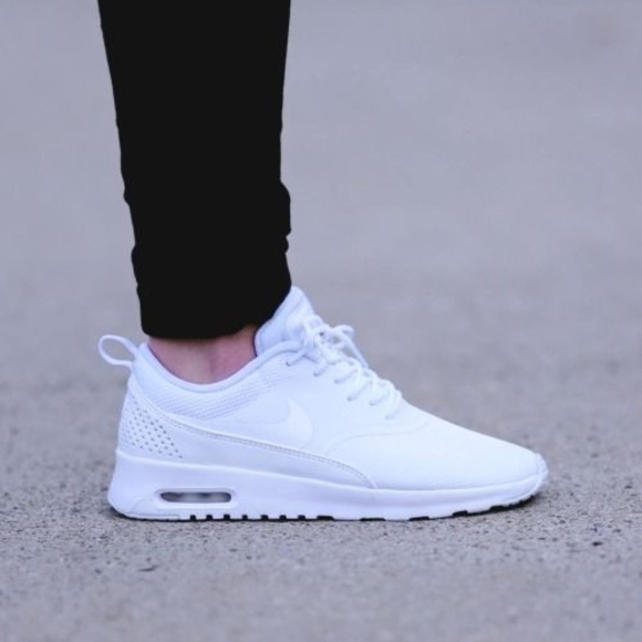 competitive price b6267 3720c Nike Women s Air Max Thea Running Sneakers. M 5a8c8270fcdc3173ed50990f